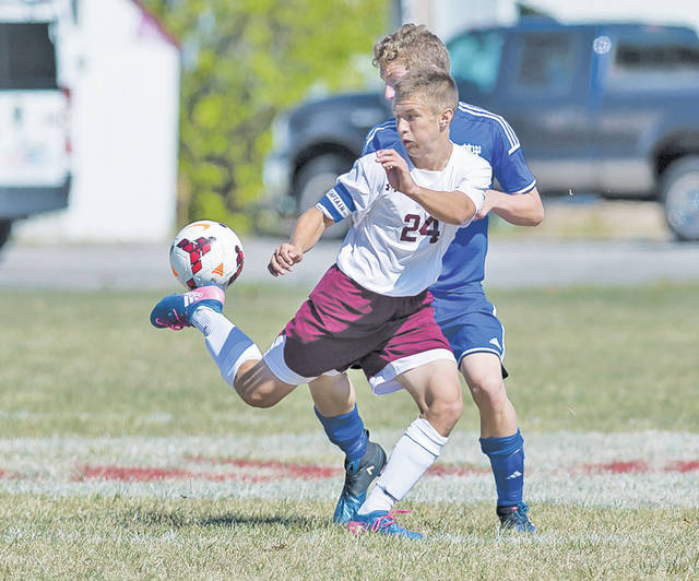 Wellington's Cole McLean flicks the ball past an Independence defender.