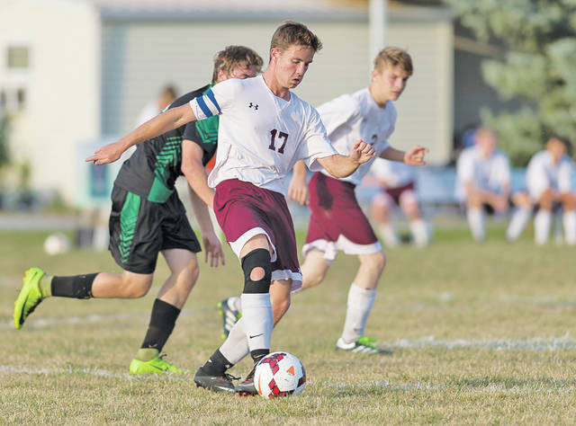 Wellington's Andrew Dooley moves the ball forward against Columbia.