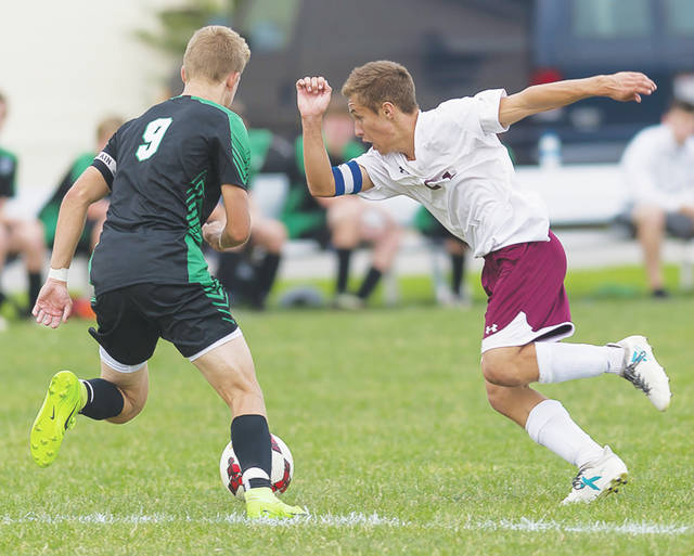 Wellington's Cole McLean cuts the ball to avoid a Columbia defender.