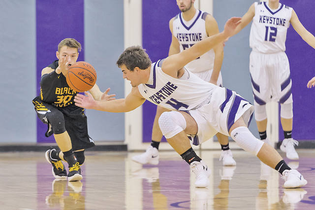 Black River's Zach Hawley and Keystone's Brody Kuhl chase a loose ball.