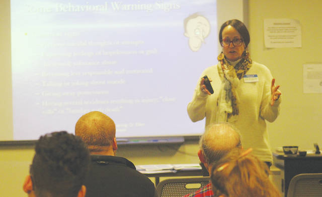 Liz Wolanski of the Lorain County Board of Mental Health speaks to residents about depression and suicide prevention Dec. 14 at the LCCC Wellington Center.