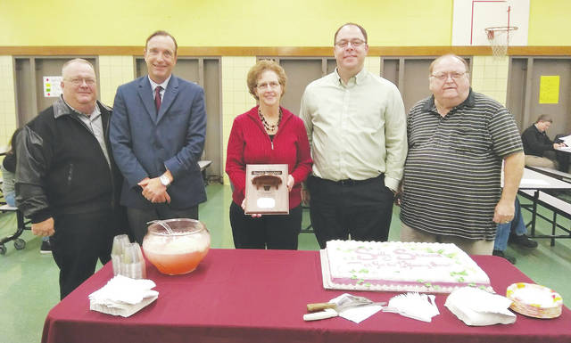 After a dozen years of service, Sally Stewart is thanked Dec. 19 by fellow board of education members Daniel Rosecrans, Brett Murner, Kevin Stump, and Ayers Ratliff. Stewart chose not to seek another term.