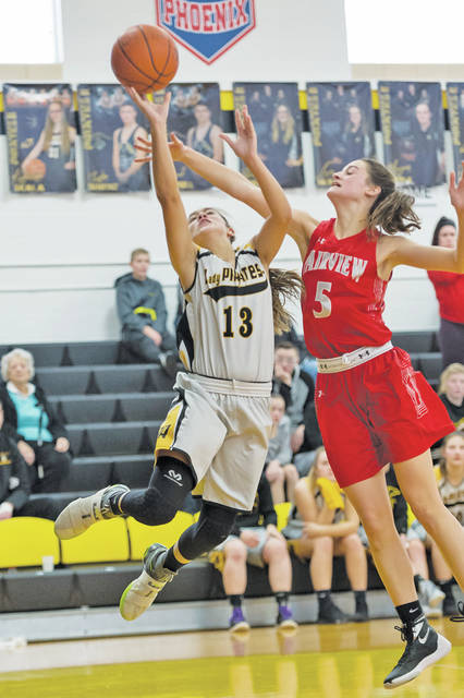 Black River's Lydia Wacker gets fouled by Fairview's Julia Costas on her way to the basket.