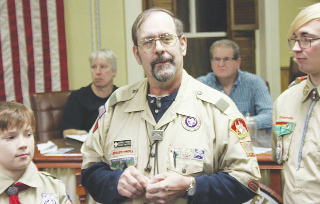 Darrell French retires Jan. 2 after 21 years as scoutmaster of the Wellington Boy Scouts. He was recognized by village council and given a standing ovation by Wellington scouts and loved ones in the audience.