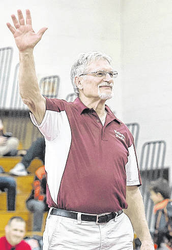 Wellington coach John Sedlick acknowledges the crowd Jan. 11 as he is announced. He is retiring after coaching Dukes wrestlers for 46 years.