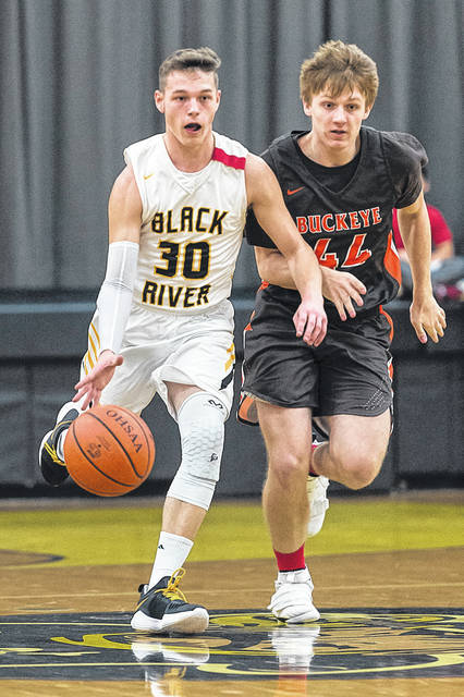 Black River's Zach Hawley brings the ball up on offense against Buckeye.