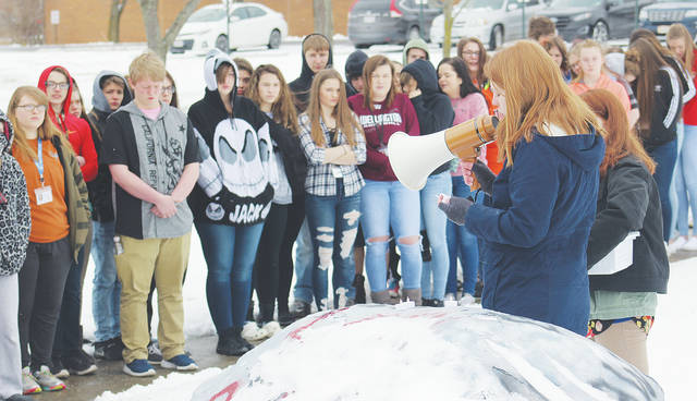 Wellington High School juniors Grace Broome and Meredith Becher lead a walkout March 14 in protest of gun violence.