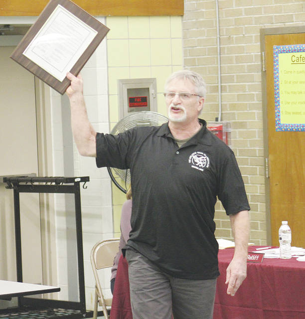 John Sedlick thanks the school district March 20 for his 46 years as wrestling coach at Wellington High School.