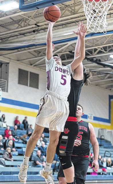 Wellington's Mason McClellan gets two points on a layup against Manchester.