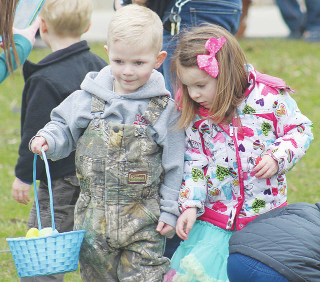 Jace Taylor of Wellington and Avery English of Pennsylvania seek out treasures Saturday during the Wellington Easter egg hunt.