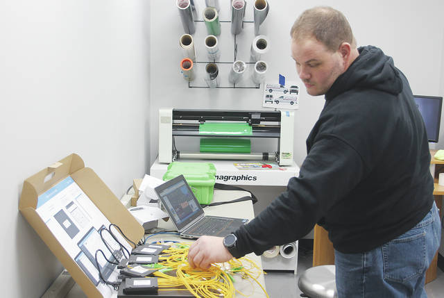 Matt Fridenstine, president of North Coast Wireless Communications, tests out connections for new 50 to 500 megabit per second fiber-optic service that he says will be available for Wellington customers this summer.