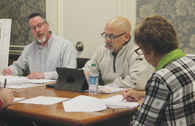 Village manager Steve Dupee recommends the freezing of police tiered pay until further notice.