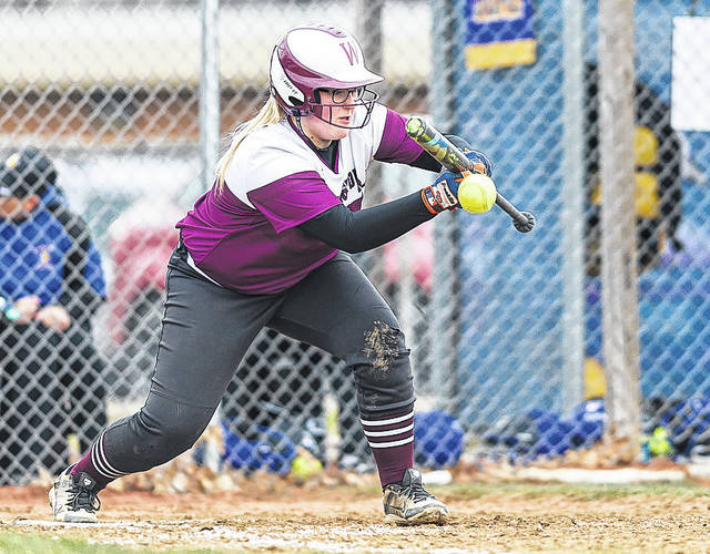 Wellington's Kendal Brasee puts down a sacrifice bunt to move a runner at Clearview.