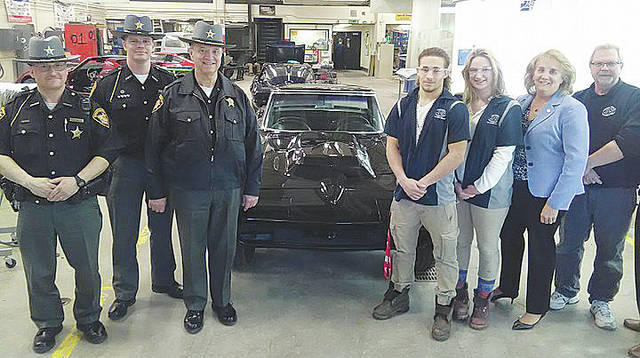 JVS students Megan Rehm and Marco Gonzalez are thanked by county sheriff Phil Stammitti, deputies, and school officials April 20 for restoring a 1966 Corvette used as the county's official DARE car.