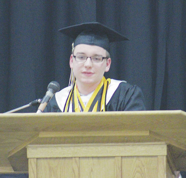 Valedictorian Jason Wright greets classmates Saturday during Black River High School's commencement ceremony.