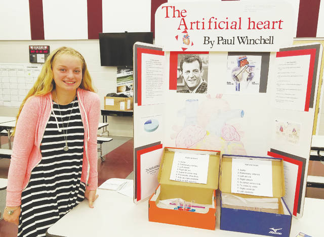 Eighth-grader McKenna Chappell displays her research on the artificial heart.