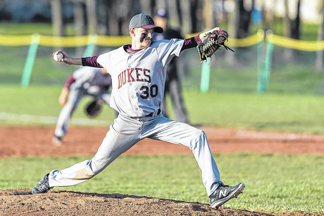Wellington's Ben Bliss winds up for a pitch against Buckeye.