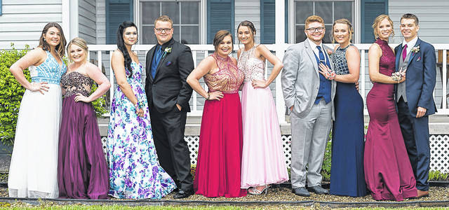 Wellington High School students gather for pictures at Makaylin Moore's house before prom.