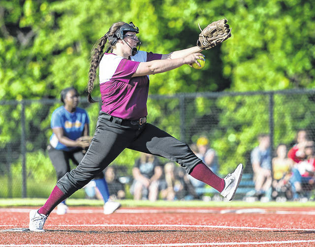 Wellington's Amber Wetherbee sends the ball speeding to the plate.