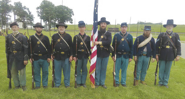 Civil War reenactors from the 82nd Ohio Volunteer Infantry Unit pose for one of many pictures. Wellington High School history teacher John Perry is on the far right.