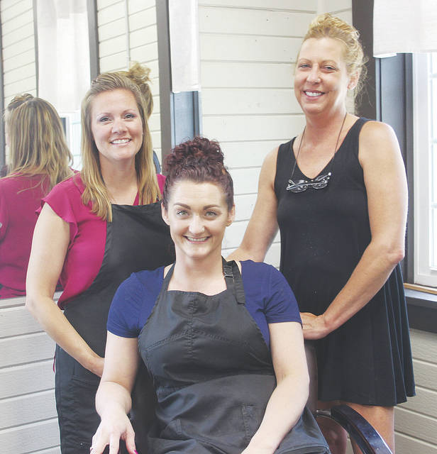 Salon Image owners Melanie O'Neal, Jamie Lynn Leiby, and Tina Norton celebrate a move to a new permanent home at 225 Kelly St.