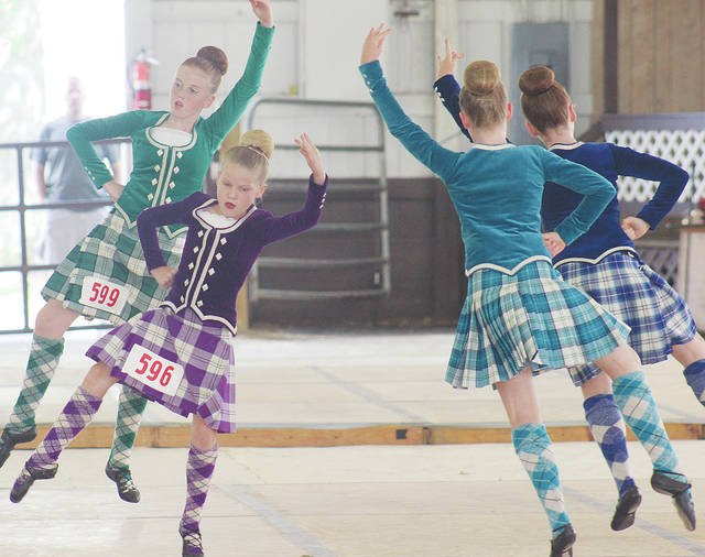 Claire Vansteenkiste of Michigan, Isobel Wilby of Ontario, Joelle Higgit of Ontario, and Ava Granger of Ontario show their moves in dance competition Saturday at the 2018 Ohio Scottish Games.