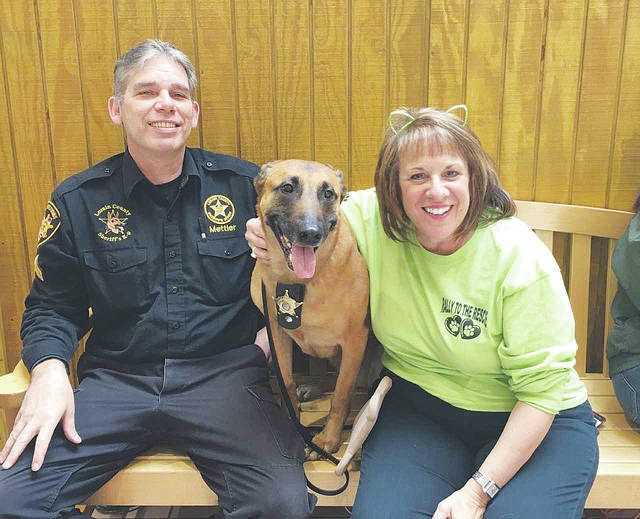 Cpl. Mike Mettler of the Lorain County Sheriff's Office, his K-9 partner Maggie, along with Partners With Paws of Lorain County president Lorie Wilber, are looking forward to this Sunday's Dog Days of Summer festival.