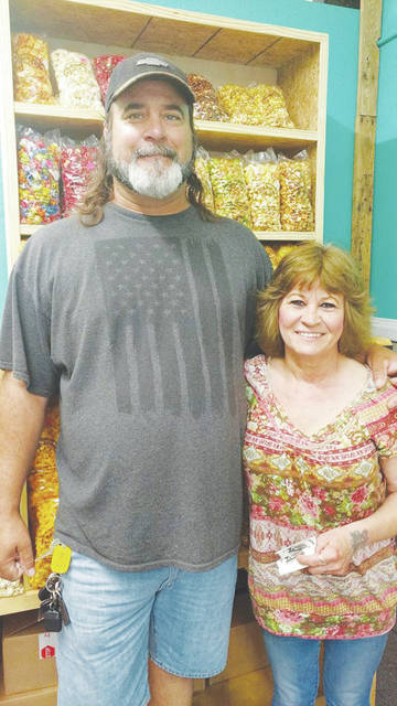 Owner Susan Andras and her boyfriend Jack Estep welcome customers June 1 during the Snak Shak's grand opening.