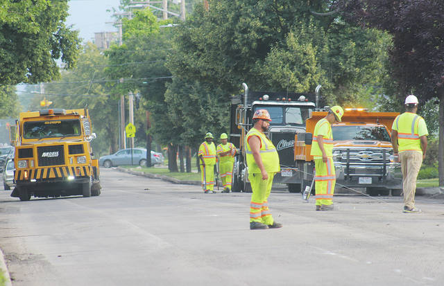 ODOT crews work into the evening Monday near Wellington High School as part of a $1.7 million repaving of Rt. 58.