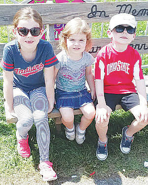 Brigid, Teagan, and Conor Grady, siblings from North Ridgeville, take a quick breather on a bench.