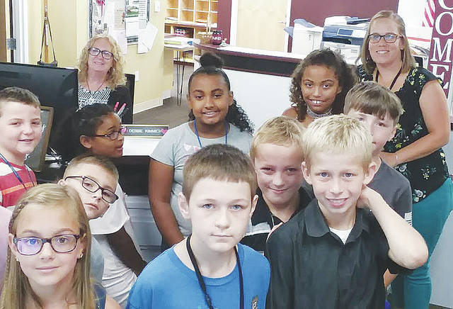 Teacher Megan Birchfield introduces her fourth-graders to McCormick Middle School office secretary Debbie Kimmich.