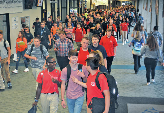 Lorain County JVS students head to their first period classes for the new school year.