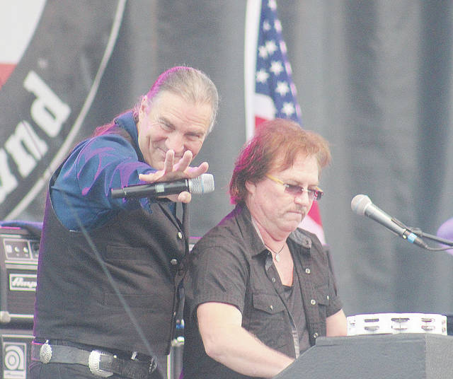 Lead singer Max Carl and keyboardist Tim Cashion of Grand Funk Railroad greet crowd members Monday night at the Lorain County Fair.