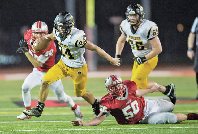 Black River's Caleb Simonson eludes Fairview's Alex Barnhart for a late game first down.