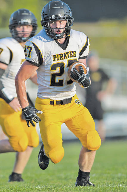 Black River's Alex Vormelker heads for the end zone in the first quarter at Northwestern.