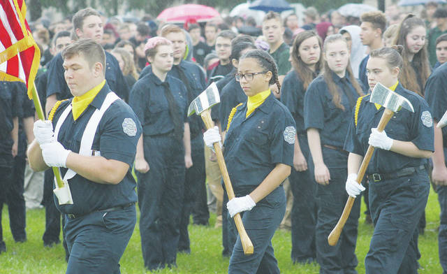 Lorain County JVS students form an honor guard Tuesday during the school's annual Sept. 11 memorial ceremony.