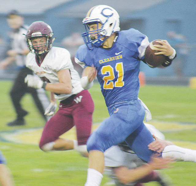 Wellington's Mason McClellan pursues Clearview's Drew Engle Friday night during a 49-0 defeat on the road.