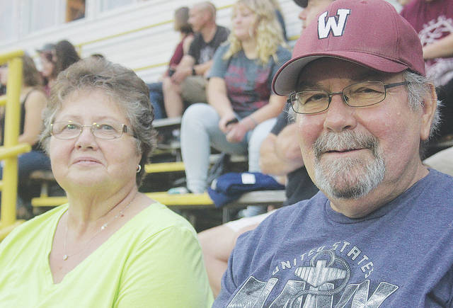 Beckie and Rich Glascoe watch their granddaughter, WHS cheerleader Emily Weegman, perform Friday night.