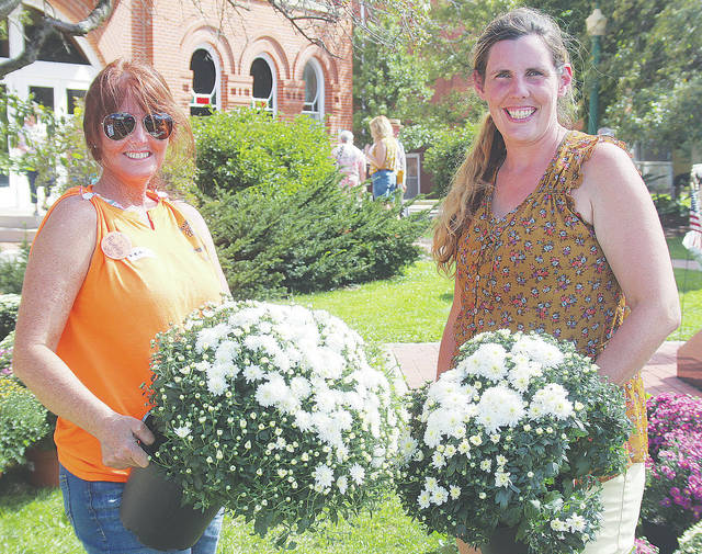 Wendy Maxwell and Liz Hook of Wellington's Hook's Greenhouse show off fresh mum arrangements during the 36th annual Harvest of the Arts.