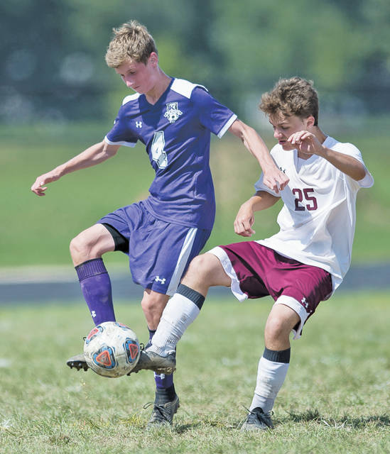 Wellington's Josh Mitterling knocks the ball away from Keystone's Tristin Miller.