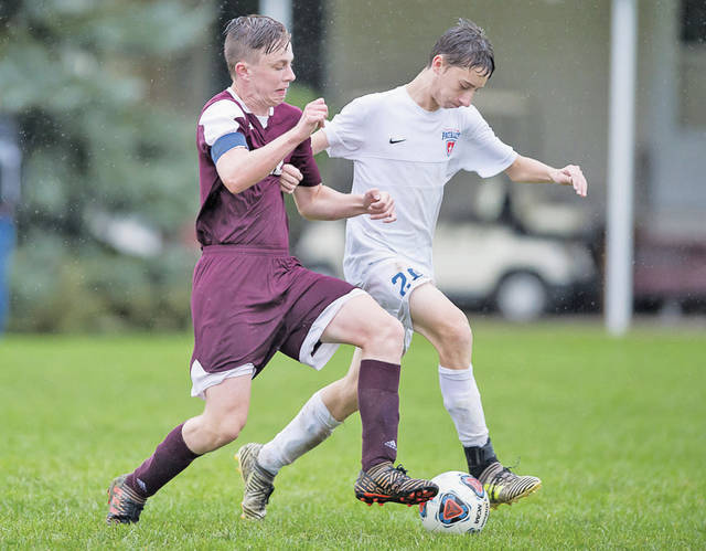 Wellington's Cory Feron fights for control of the ball.