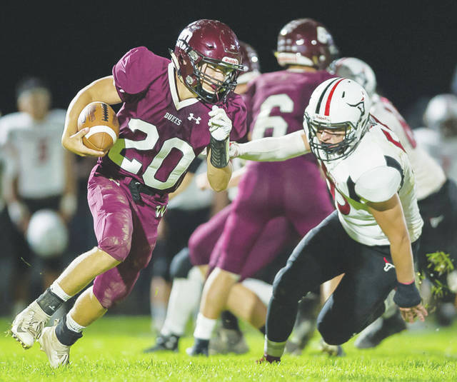 Wellington's Tyler Moore heads for the corner against Lutheran West Friday during a 50-6 defeat.