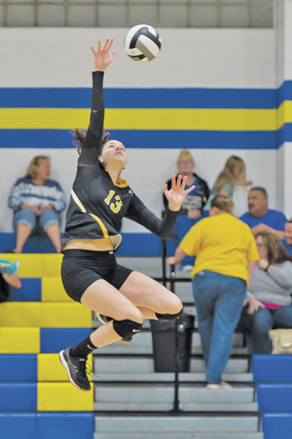 Black River's Olivia Rayk goes for the kill at Clearview.