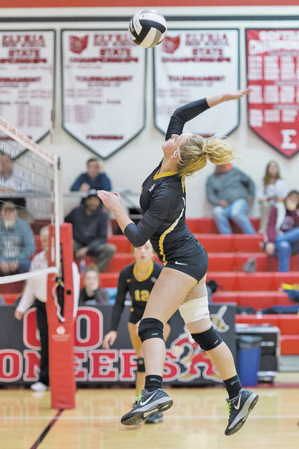 Black River's Morgan Young goes for the kill against EC.