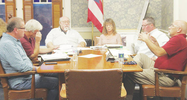 Village officials discuss a proposed downtown parking pass program on Monday.