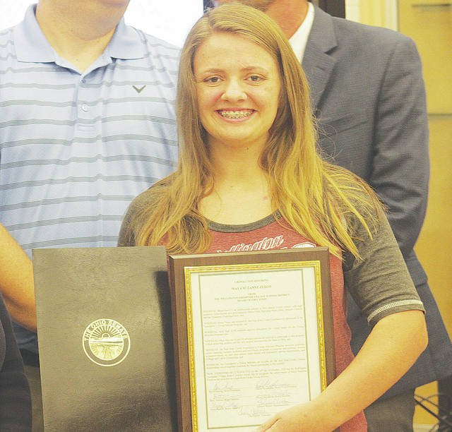 McCormick Middle School eighth-grader Maya Feron is congratulated Oct. 16 for being accepted into the Jack Kent Cooke Foundation's Young Scholars program. She is Ohio's lone recipient in the latest round of applications.