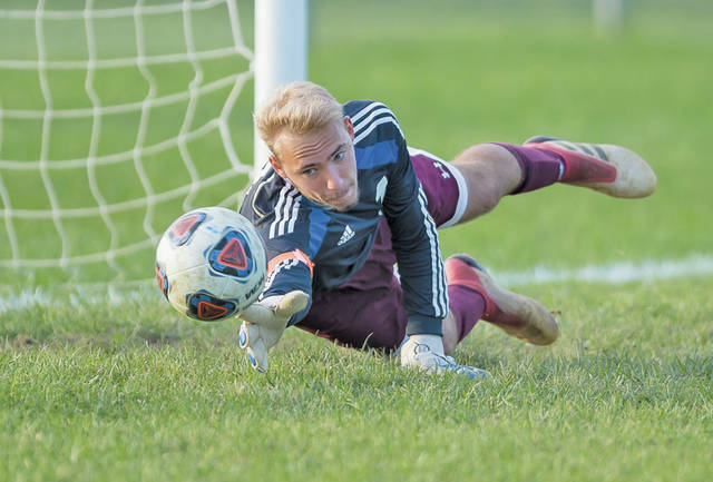 Wellington Keeper Stephen Del Campo gets just enough touch on the ball to deflect this Fairview shot.