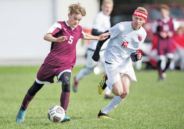 Wellington's John Peterson takes the ball away from pressure by Firelands' Chace Riley.