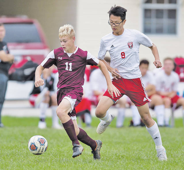 Wellington's Derrick Andolsek gets past a Lutheran West defender in non-conference action.