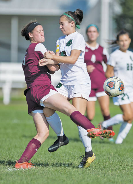 The Dukes' Madalyn Mull collides with Elyria Catholic's Alexa Oberg as they go after a loose ball.